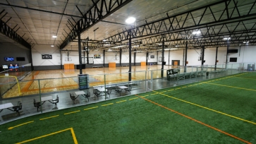 Develop an indoor sports complex.